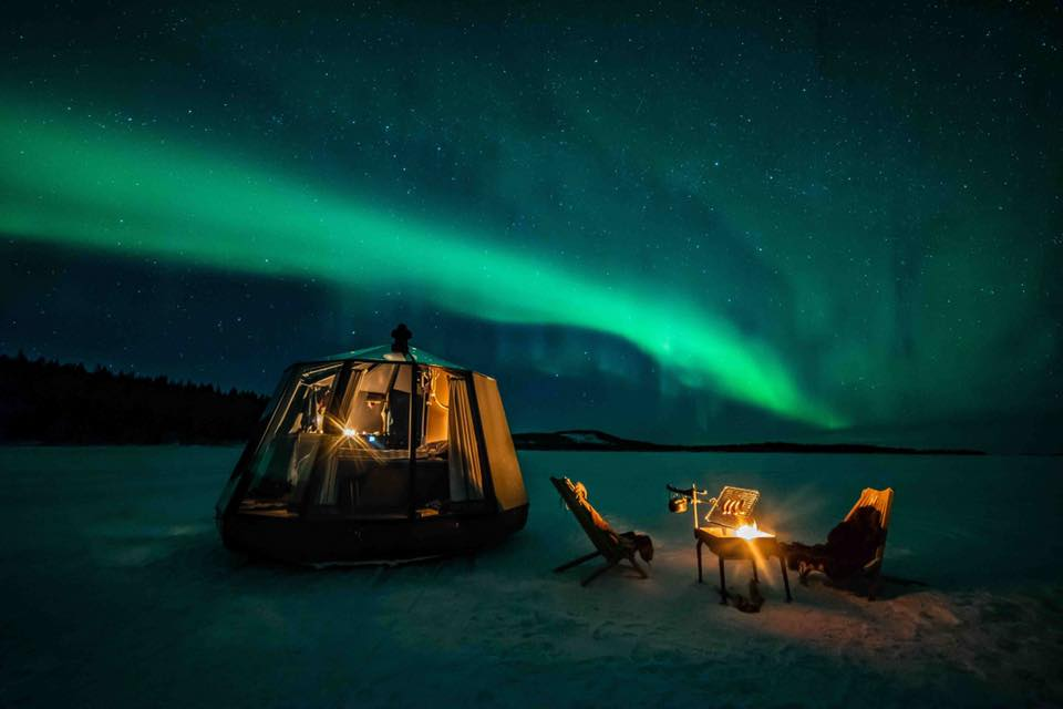 Northern lights captured on a lake in Lapland