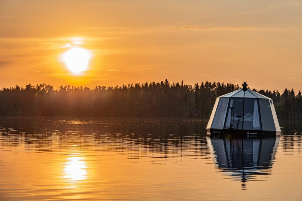 AuroraHut Glass Igloo boat floating at lake Ranua, Finnish Lapland, during summer 2019 - Arctic Guesthouse & Igloos