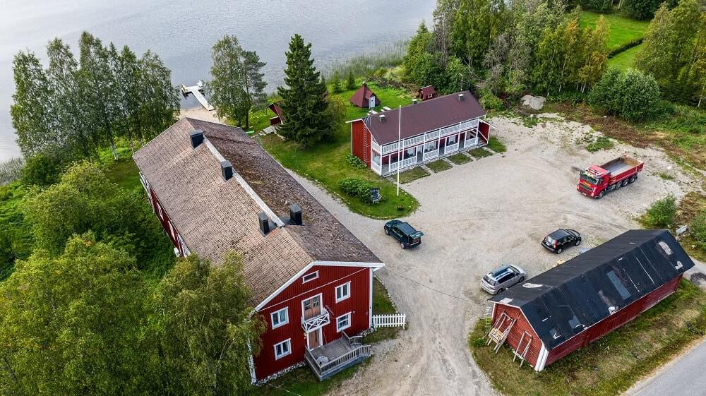 Arctic Guesthouse & Igloos' main buildings filmed from the air.