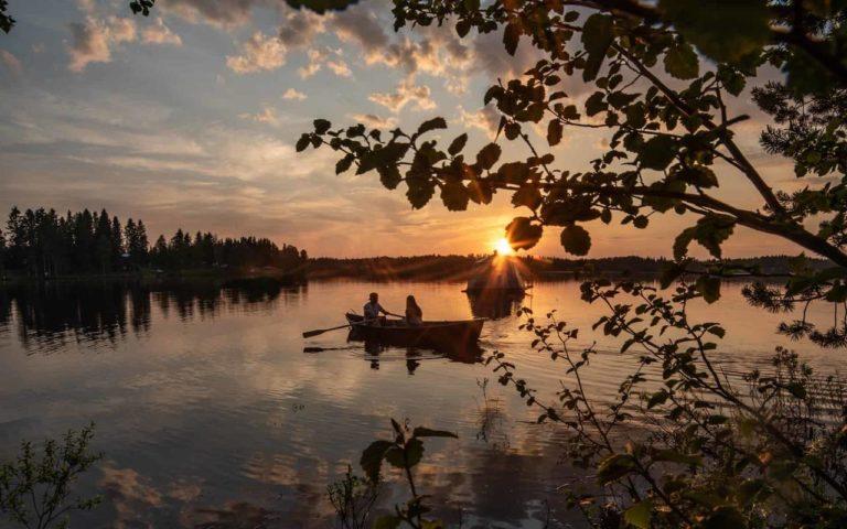 AuroraHut Glass Igloo boat and a rowboat on lake Ranua during summer