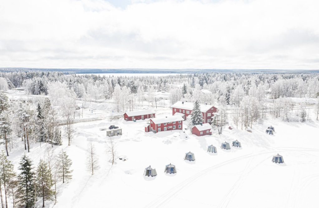 Arctic Guesthouse & Igloos - Gasthaus Ranua, 10 AuroraHut Glass Igloos and a mobile sauna cart in Ranua, Finnish Lapland during winter 2020.