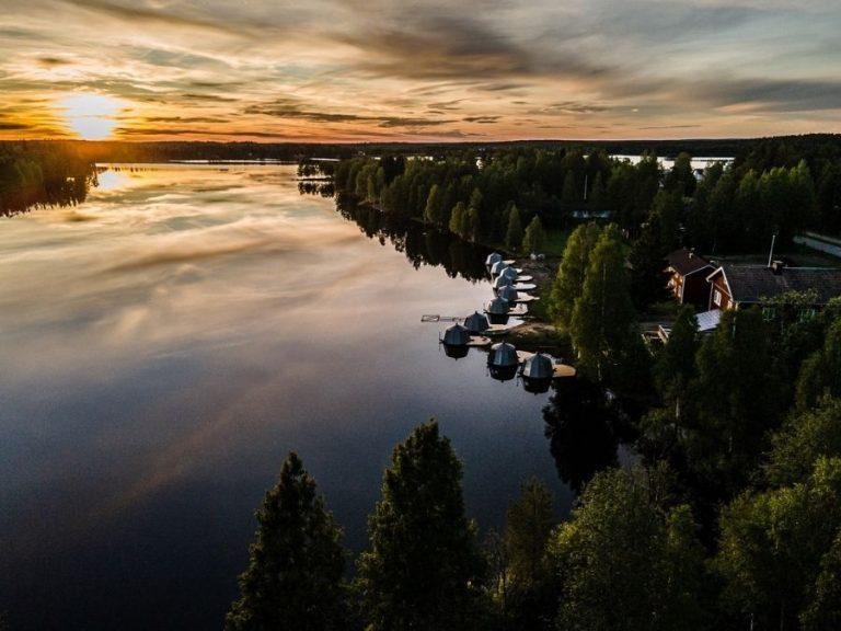 The midnight sun pictured on top of lake Ranuanjärvi in Finnish Lapland in summer 2020
