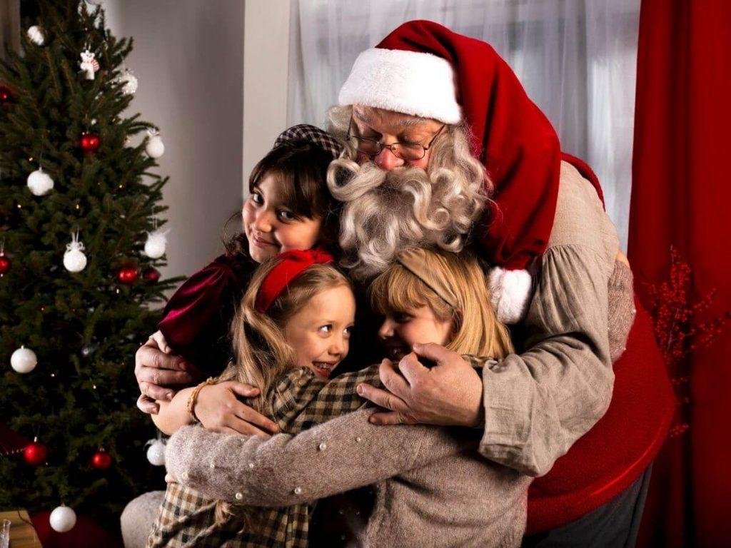 Santa claus and children in Christmas morning in Finland