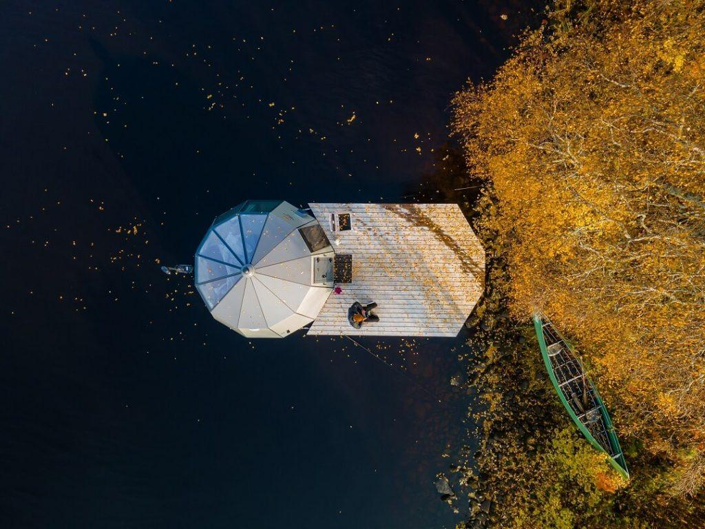 AuroraHut glass igloo boat and fall foliage in Finnish Lapland in autumn